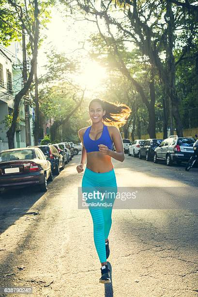 beautiful young woman jogging on a nice sunny day