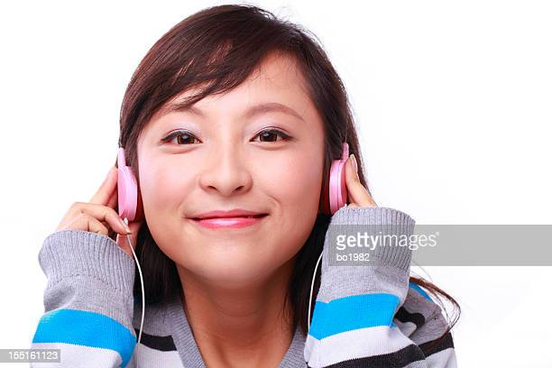 beautiful young woman listing to music