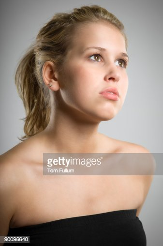 Beautiful young woman, looking away