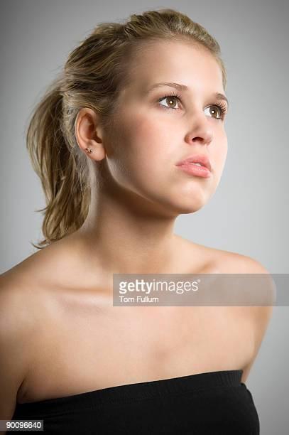 Beautiful young woman, looking away