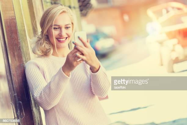 Beautiful young woman making