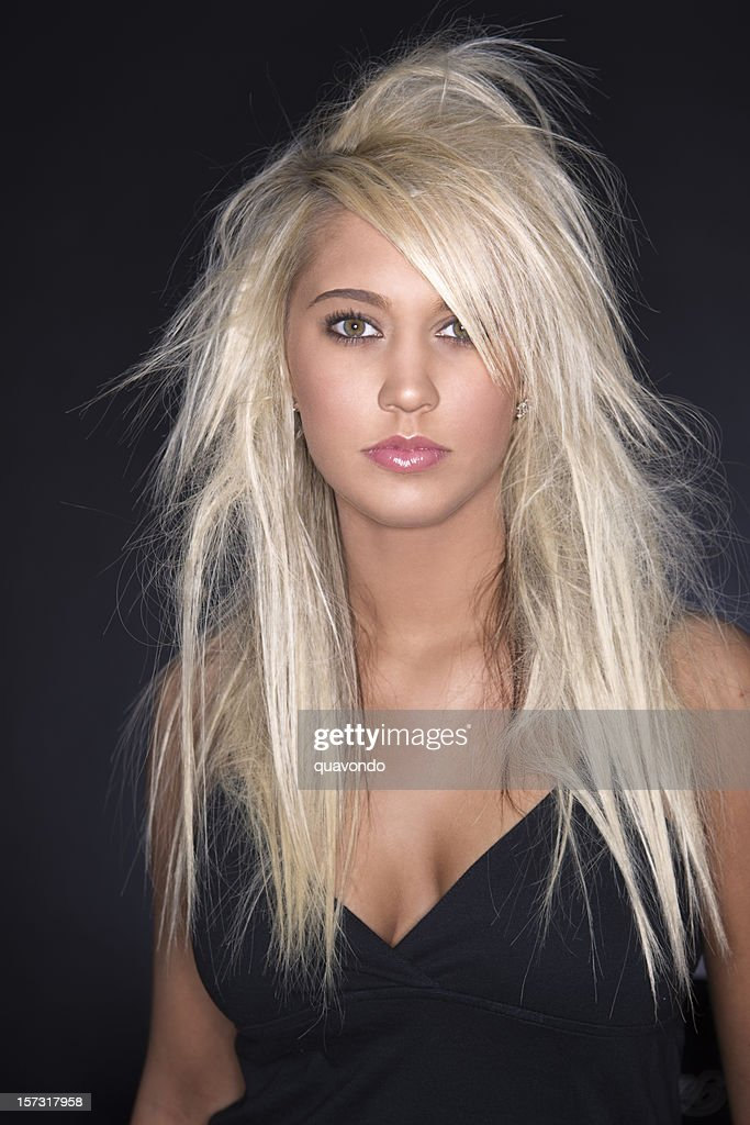 Beautiful Young Woman Model with Blond Hair Extensions on Black