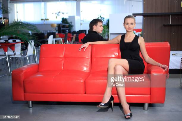 beautiful young woman on a red couch