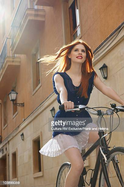 Beautiful young woman on bicycle