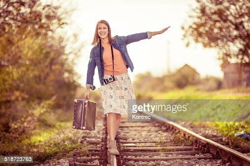 Beautiful young woman on railroad tracks