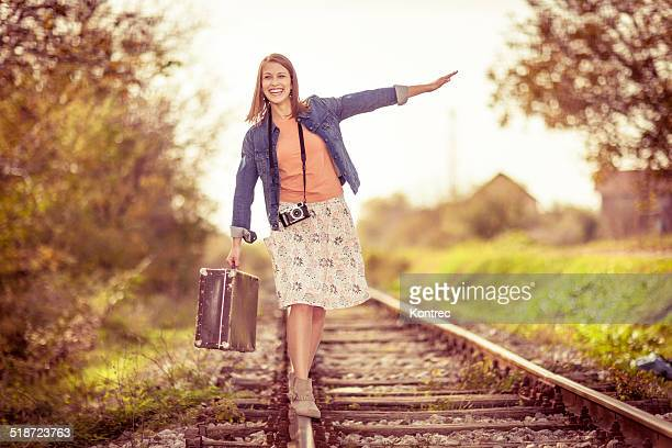 Beautiful young woman on railroad tracks
