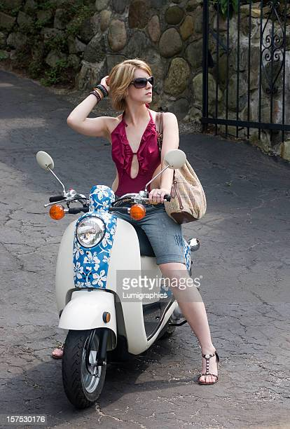 Beautiful young woman on scooter