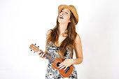 Beautiful young woman playing ukulele