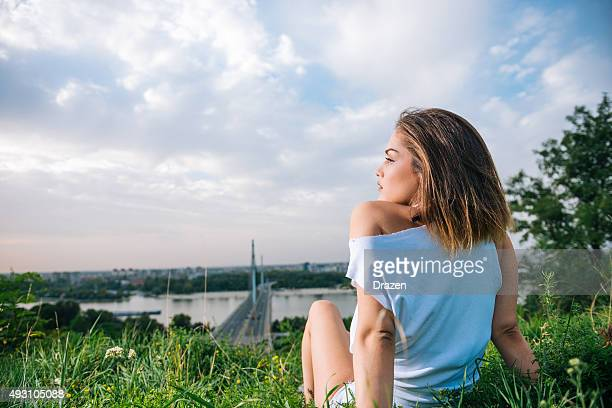 Beautiful young woman posing in casual fashion in suburban setting