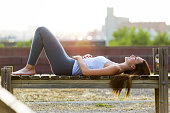 Portrait of beautiful young woman relaxing in the park.