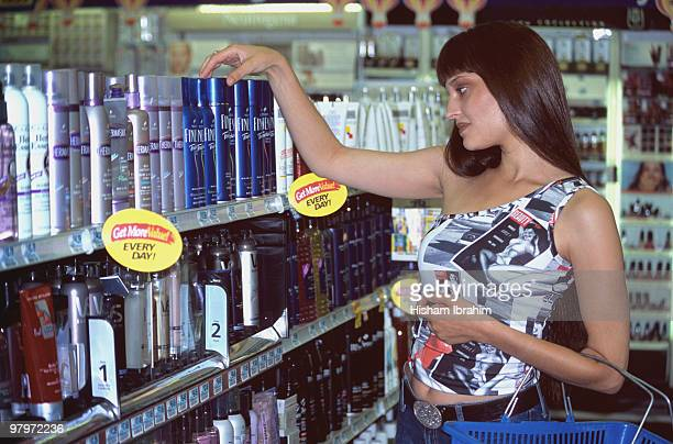Beautiful young woman shopping in a Drugstore