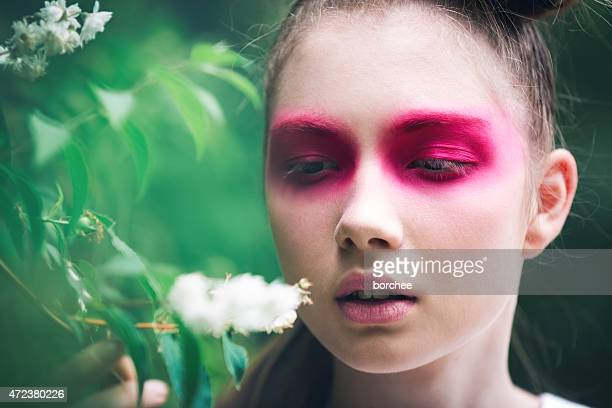 Beautiful Young Woman Smelling The Flower