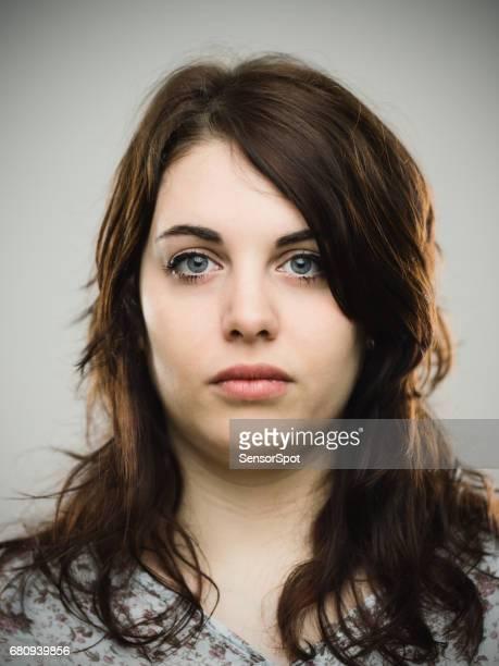 Beautiful young woman staring at camera