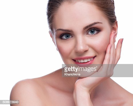 Beautiful Young Woman Touching Her Face.Fresh Healthy Skin.Isolated on White : Stock Photo