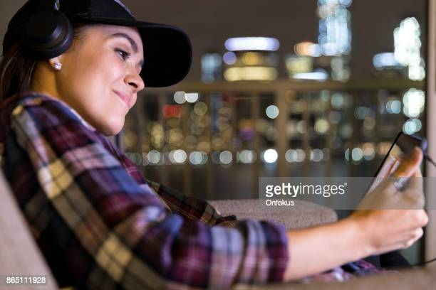 Beautiful Young Woman Using Digital Tablet at Home