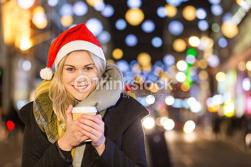 70467f89eea5c Beautiful Young Woman Wearing Santa Hat In London Stock Photo ...