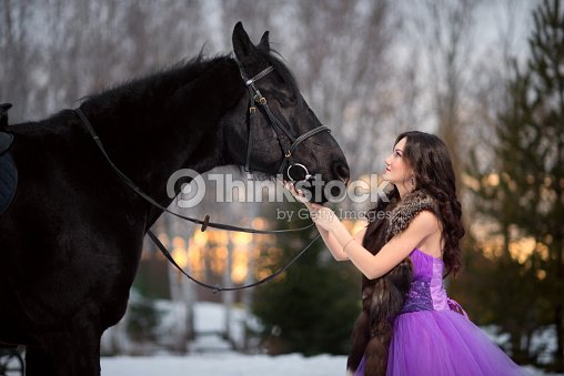 b9638aee7732 Beautiful Young Woman With A Black Horse Stock Photo   Thinkstock