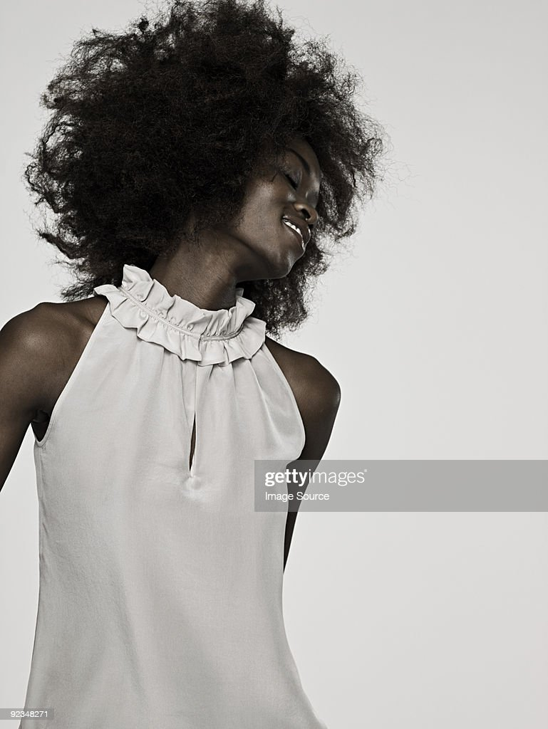 Beautiful young woman with an afro dancing