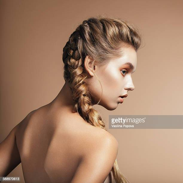 Beautiful young woman with braids