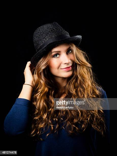 Beautiful Young Woman with curly hair on black portrait