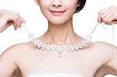 Beautiful young woman with diamond necklace