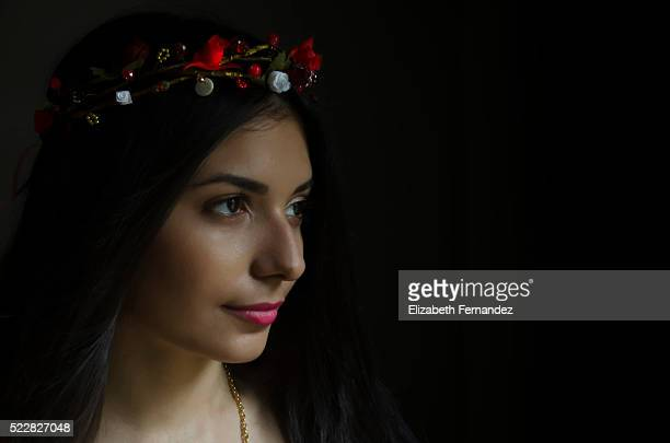 Beautiful young woman with flower wreath in her hair.