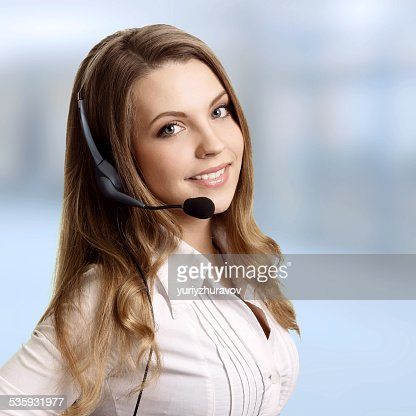 Beautiful young woman with headphones and microphone : Stock Photo