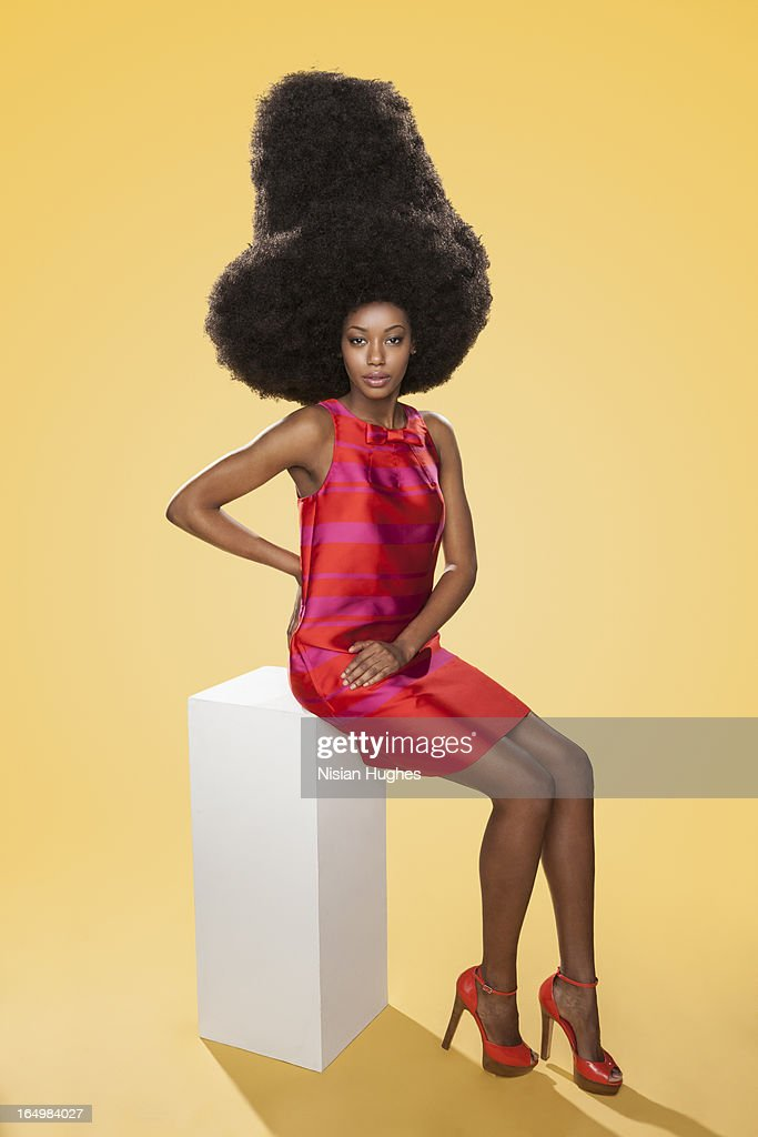 Beautiful young woman with large afro : Stock Photo
