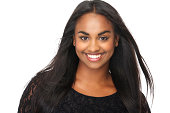 Close up portrait of a beautiful young woman with long flowing hair, smiling on isolated white background