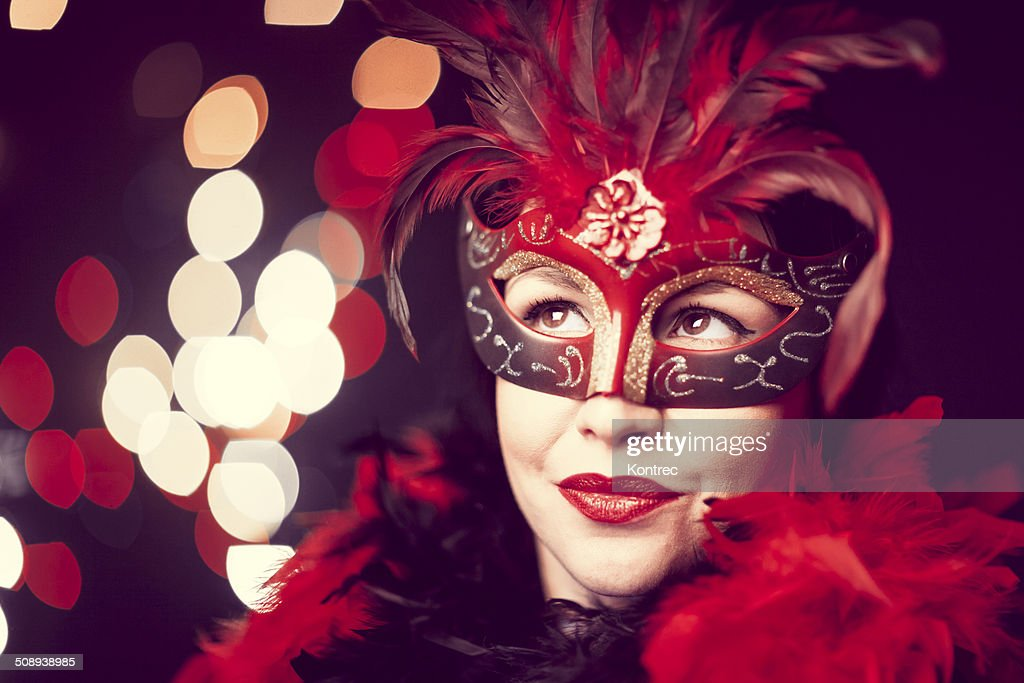 Beautiful young woman with masquerade mask