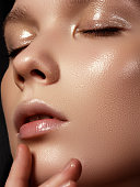 Beautiful young woman with perfect clean shiny skin, natural fashion makeup. Close-up woman, fresh spa look'r'n'r'n