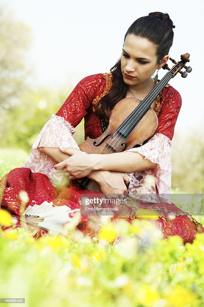 Beautiful young woman with violin outdoor : Stock Photo