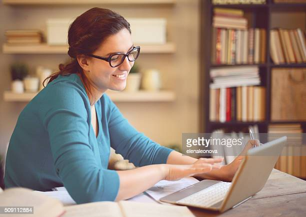beautiful young woman working at home