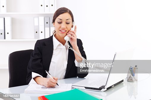 Beautiful young woman working in office