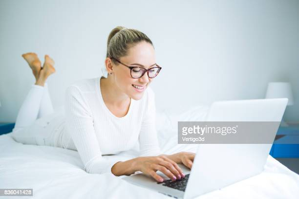 Beautiful young woman working with laptop