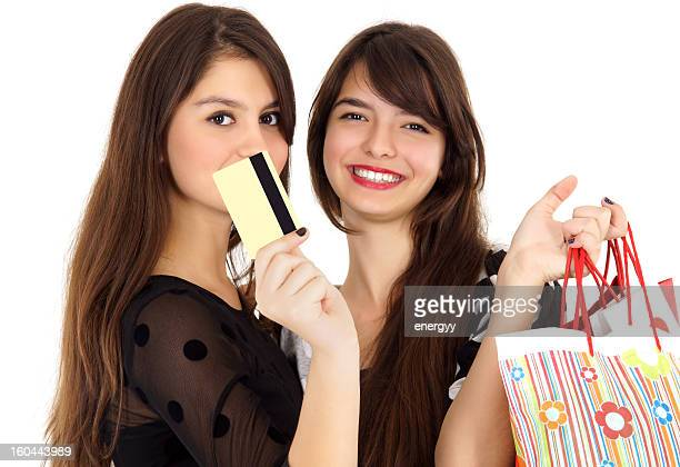 Beautiful young women shopping with credit card