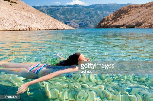 Beautiful young women swimming