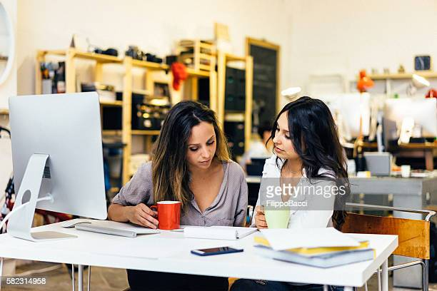 Beautiful Young Women Working Together In A Startup