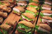 Beautifully multicolored decorated catering banquet table sandwiches, sandwich on corporate party event or wedding celebration.