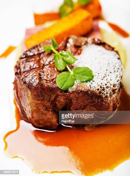 Beautifully garnished restaurant meal of grilled fillet steak