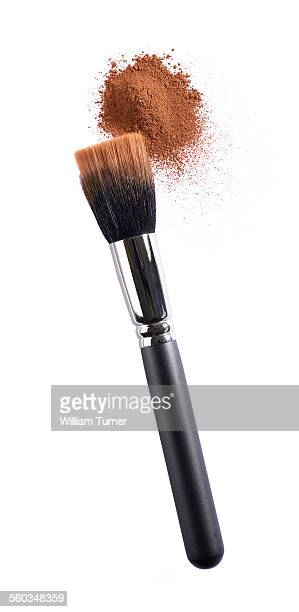 Beauty brush with bronze or tan powder make up