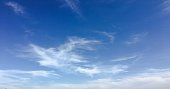 Beauty cloud against a blue sky background. Clouds sky. Blue sky with cloudy weather, nature cloud. White clouds, blue sky and sun
