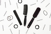 Beauty composition with tools for hairdresser on white background. Flat lay, top view
