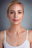 portrait of middle age woman with part of perfect skin and part with unperfected skin