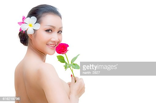Beauty Fashion Model Woman face. Portrait with Red Rose flower. : Stockfoto
