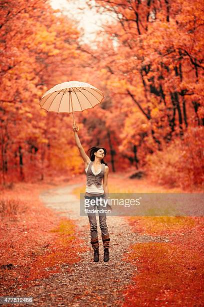Beauty girl in love jump with umbrella
