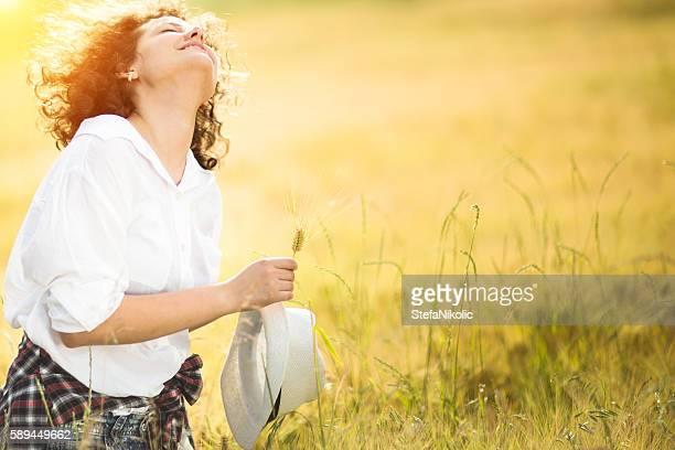 Beauty Girl Outdoors enjoying nature