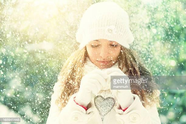 beauty holding heart shaped christmas ornament
