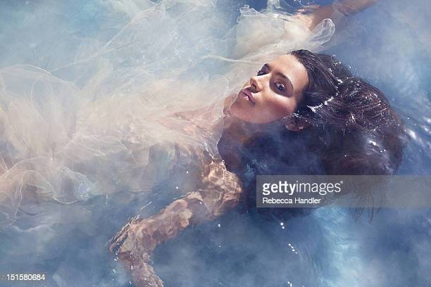 Beauty image of woman in water with smoke
