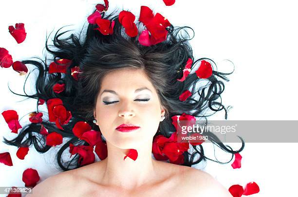 Beauty in bed of red roses